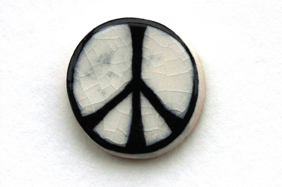 first peace symbol badge